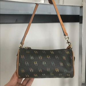 Adorable Dooney and Bourke mini barrel bag.